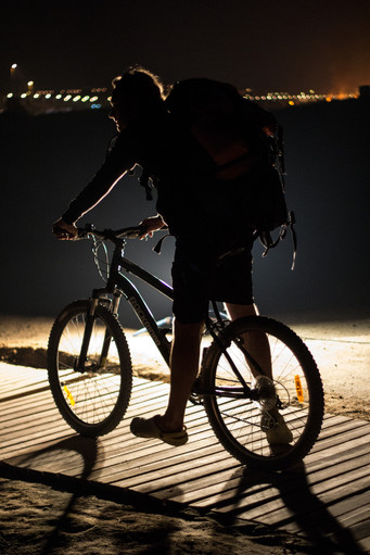 Man riding a bicycle in the dark