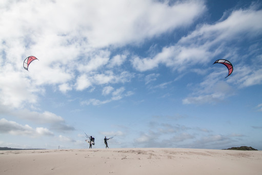 Kitesurfers on the beach