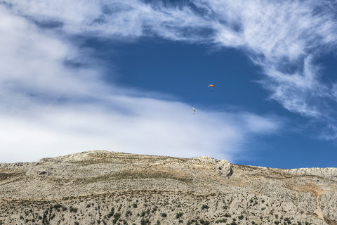 Paragliders over the Mountains
