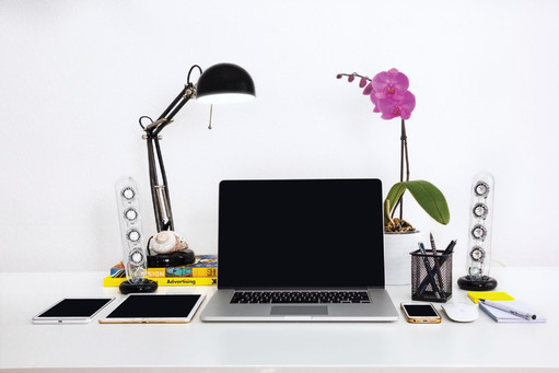 Workplace with laptop, tablet, phone on the table