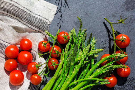 Asparagus and Tomatoes in a Basket