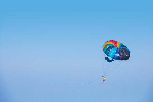 Parachutist flying behind the motor boat
