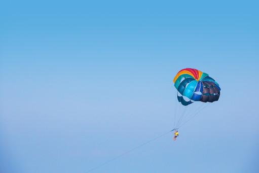 Parachutist flying behind the motor boat
